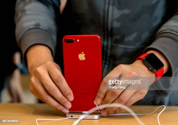 A customer is trying a new red iPhone 7 Red iPhone 7 and 7 Plus which are called 'China Red' and popular among Chinese customers came into market on...
