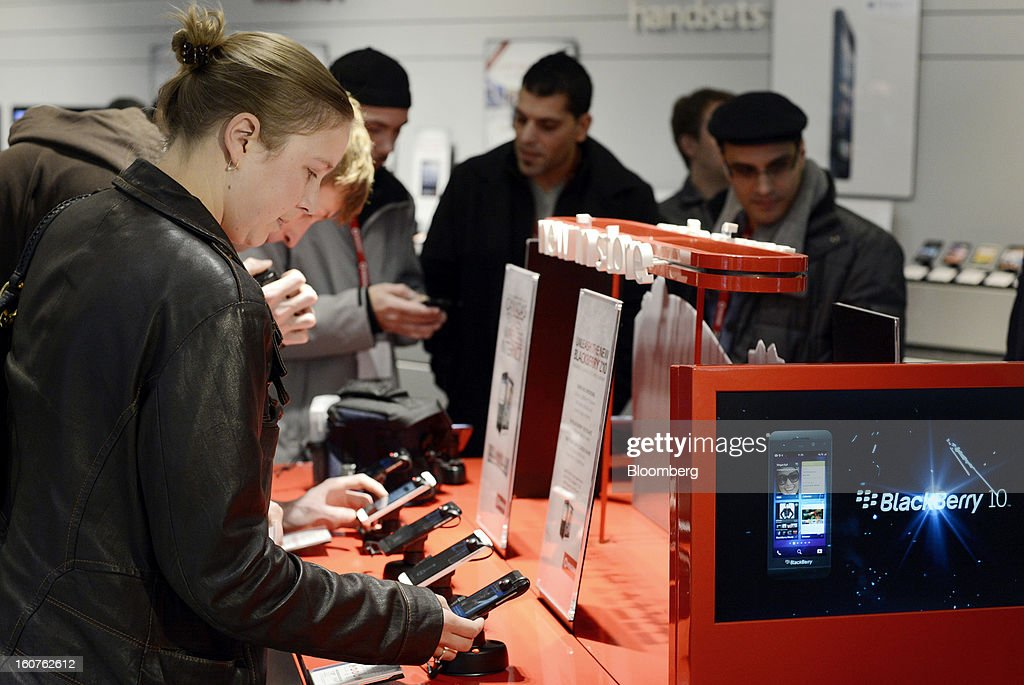 "Customer Katie Strong views a Blackberry Z10 device on the first day of sales at a Rogers Communications Inc. store in Toronto, Ontario, Canada, on Tuesday, Feb. 5, 2013. Thorsten Heins, president and chief executive officer of BlackBerry, said early sales of the Z10 smartphone are ""encouraging"" and that users are switching from other platforms. Photographer: Aaron Harris/Bloomberg via Getty Images"