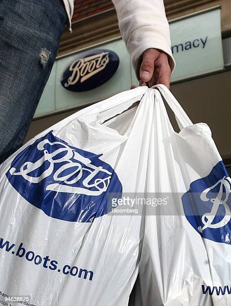 A customer leaves a Boots pharmacy in Hornchurch Essex UK on Friday April 20 2007 Guy Hands's Terra Firma Capital Partners Ltd raised its bid for...