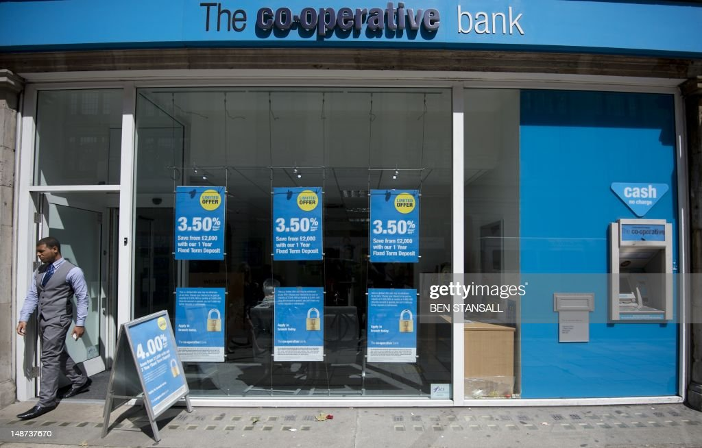 A customer leaves a branch of the Co-operative Bank in London on July 19, 2012. Britain's retail bank sector faced further shake-up on July 19 as state-rescued Lloyds Banking Group agreed to sell 632 branches at a loss to The Co-operative Group after an EU competition ruling.