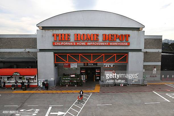 A customer leaves a Home Depot store on November 18 2014 in Colma California Home Depot reported a 14 percent increase in third quarter earnings with...