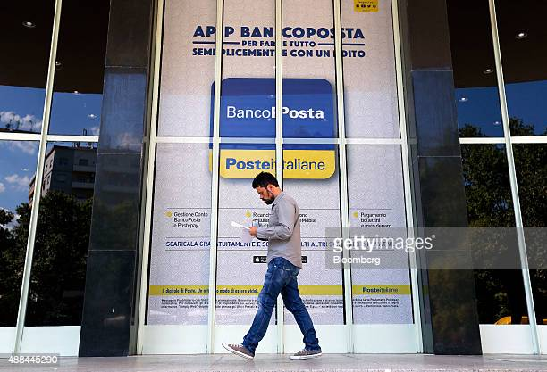 A customer leaves a Poste Italiane SpA post office in Rome Italy on Thursday Sept 10 2015 Italy is proceeding with a plan to sell as much as 40...