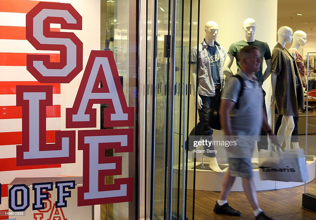 A customer leaves a shop advertising summer sales on August 1, 2012 in Berlin, Germany. German retailers began their annual summer clearance sale on Monday, offering deep discounts of up to 80 percent on warm weather items as they prepare to stock up for the autumn shopping season.