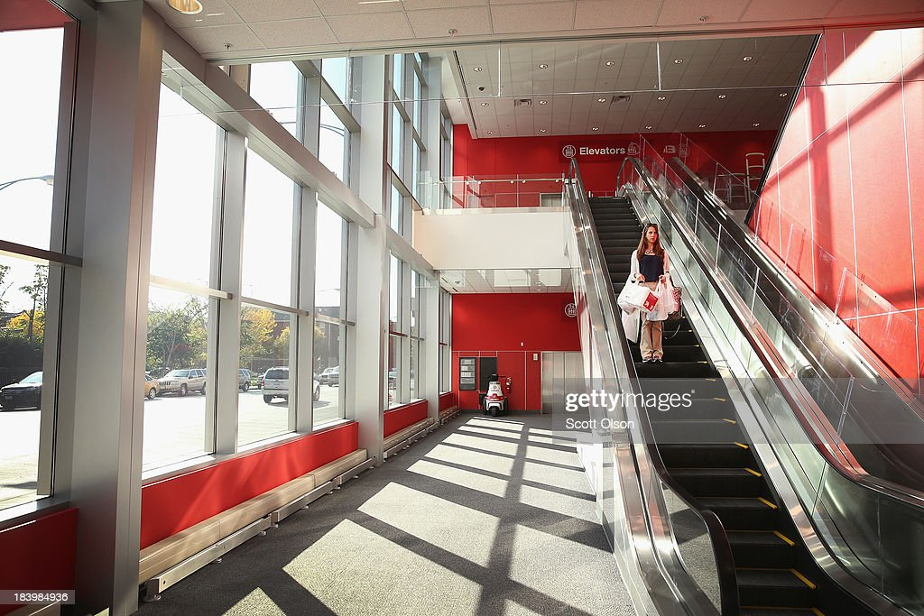A customer leaves a Target store with her purchases on October 10, 2013 in Chicago, Illinois. The store, which opened on October 8, was built on land where the notorious Cabrini-Green housing project once stood. The last of the Cabrini-Green high-rise homes were demolished two years ago. The housing project has been replaced with townhomes and retail shops, with some of the property being left vacant.