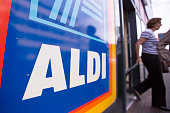 A customer leaves an Aldi supermarket store in London UK on Monday June 29 2015 The growth of Aldi and fellow Germanowned discounter Lidl has changed...