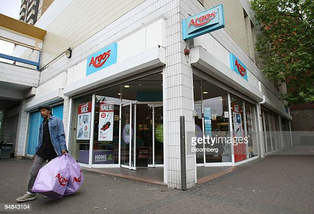A customer leaves an Argos shop owned by Home Retail Group plc in London UK on Wednesday June 18 2008 European confidence dropped more than...