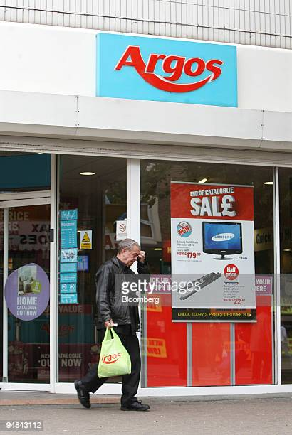 A customer leaves an Argos shop owned by Home Retail Group plc in London UK on Wednesday June 18 2008 Home Retail Group plc operates chains of home...
