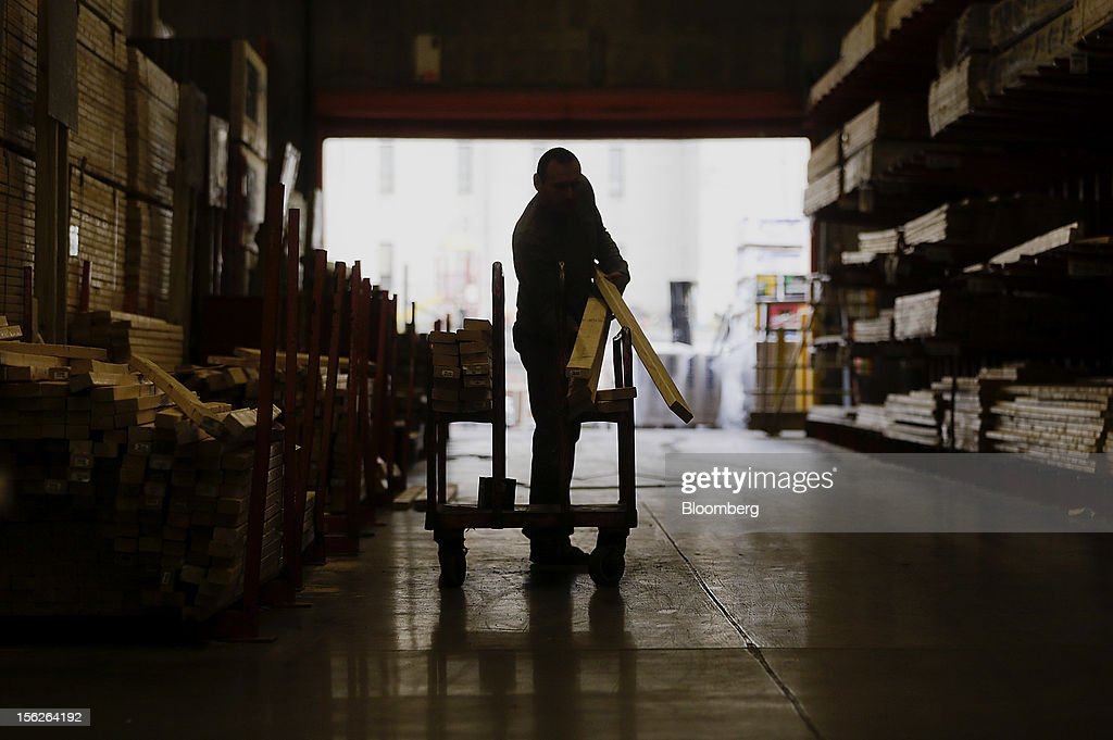 A customer loads a cart with lumber at a Home Depot Inc. store in Washington, D.C., U.S., on Monday, Nov. 12, 2012. Home Depot Inc. is scheduled to release earnings data on Nov. 13. Photographer: Andrew Harrer/Bloomberg via Getty Images