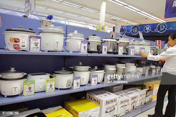 Customer looking a kitchen appliances in a supermarket in Avenida Canaval y Moreyra