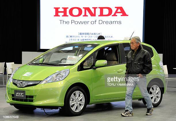 A customer looks around the showroom of Honda Motor as a Fit is displayed at the headquarters in Tokyo on January 31 2011 The Japanese auto maker...