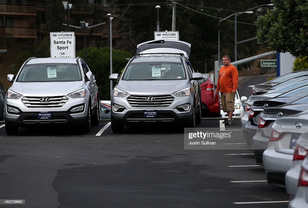 A customer looks at a brand new Hyundai Santa Fe mid-size crossover vehicle at Hyundai Serramonte on July 16, 2014 in Colma, California. According to a report by IHS Automotive, new registrations on SUVs and crossover vehicles surpassed sedans for the first time with SUVs and crossovers taking 36.5 percent of registrations while sedans registered 35.4 percent.