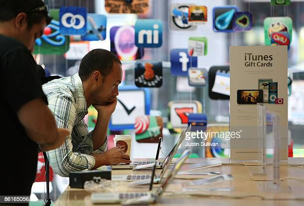 A customer looks at a display of MacBook Pro laptops at an Apple store April 22 2009 in San Francisco California California Apple announced quarterly...