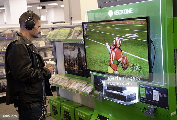 A customer looks at a display of Microsoft's nextgeneration console the Xbox One at Best Buy in Union Square in New York November 19 2013 The Xbox...
