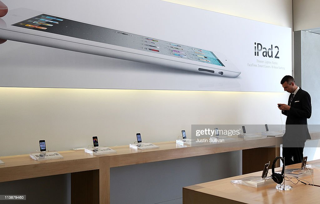A customer looks at a display of the iPhone 4 at an Apple Store following an announcement that Apple has become the world's most valuable brand on May 9, 2011 in San Francisco, California. In a report released by London based Millward Brown, Apple Inc. has surpassed Google to claim the top spot in a global ranking of brand value this year with an estimated value of more than $153 billion up 84 percent from last year.