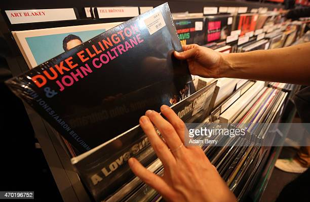 A customer looks at a Duke Ellington and John Coltrane album during World Record Store Day at Dussmann on April 18 2015 in Berlin Germany According...