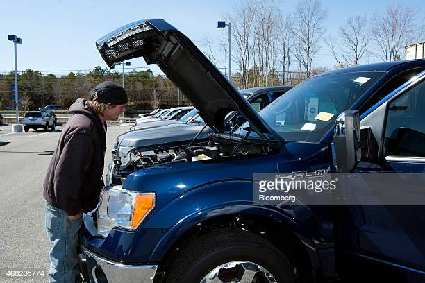 A customer looks at a Ford Motor Co F150 pickup truck at a CarMax Inc dealership in Brandywine Maryland US on Sunday March 29 2015 CarMax Inc is...