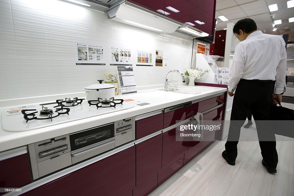 A customer looks at a Lixil Group Corp. kitchen unit displayed at the company's showroom in Tokyo, Japan, on Friday, Oct. 11, 2013. Lixil and Development Bank of Japan agreed on Sept. 26 to buy bathroom-fixtures maker Grohe Group, valuing the German company at 3.06 billion euros ($4.1 billion). Photographer: Kiyoshi Ota/Bloomberg via Getty Images