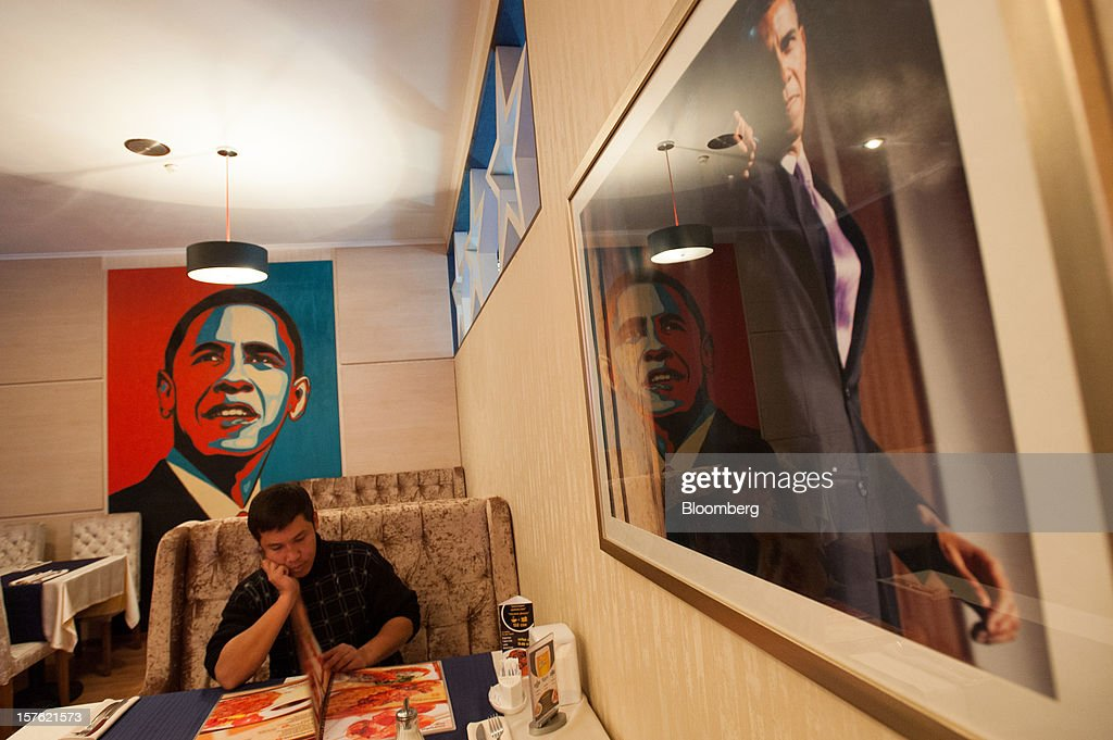 A customer looks at a menu at a restaurant called 'Obama' in central Bishkek, Kyrgyzstan, on Friday, Nov. 23, 2012. Landlocked Kyrgyzstan is the only country in the world that hosts both Russian and U.S. military bases. Photographer: Noriko Hayashi/Bloomberg via Getty Images