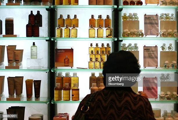 A customer looks at a product display at a Body Shop outlet in Jakarta Indonesia Sunday April 30 2006 Body Shop International Plc a UK natural...