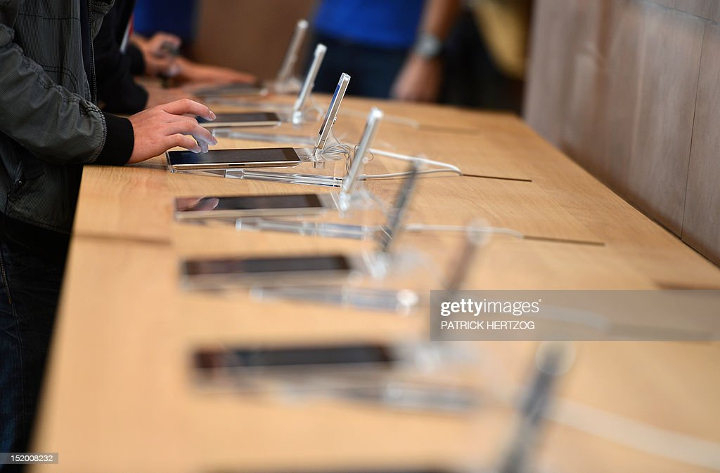 A customer looks at a tablet during the inauguration of a new Apple store in Strasbourg, eastern France, on September 15, 2012.