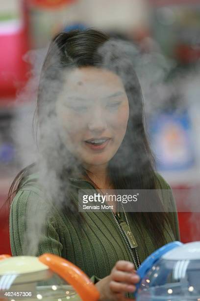 A customer looks at an air humidifier in a Gome Electrical Appliance store on January 20 2006 in Beijing China