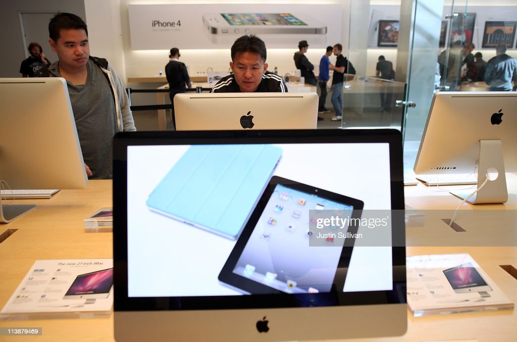A customer looks at an iMac computer at an Apple Store following an announcement that Apple has become the world's most valuable brand on May 9, 2011 in San Francisco, California. In a report released by London based Millward Brown, Apple Inc. has surpassed Google to claim the top spot in a global ranking of brand value this year with an estimated value of more than $153 billion up 84 percent from last year.