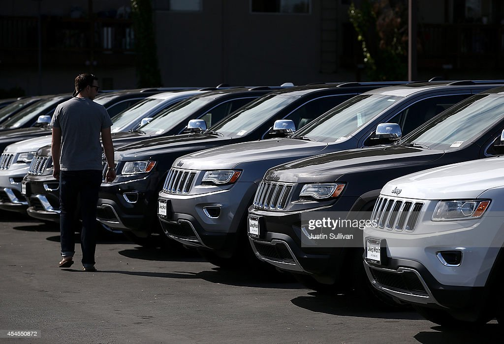 A customer looks at brand new Jeeps that are displayed on the sales lot at Chrysler Jeep Dodge Ram Marin on September 3 2014 in Corte Madera...