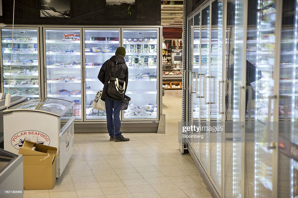 A customer looks at frozen food in a freezer cabinet inside an ICA supermarket store in Stockholm, Sweden, on Tuesday, Feb. 19, 2013. Hakon Invest AB, the minority owner of Sweden's largest food retailer ICA, agreed to take full control by acquiring partner Royal Ahold NV's 60 percent stake for 20 billion kronor ($3.1 billion). Photographer: Casper Hedberg/Bloomberg via Getty Images