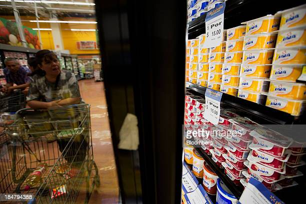A customer looks at Grupo Lala SAB brand dairy products displayed for sale at a supermarket in Mexico City Mexico on Wednesday Oct 16 2013 Grupo Lala...