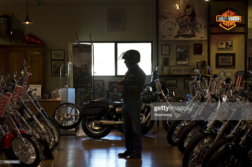 A customer looks at Harley-Davidson Inc. motorcycles on the showroom floor at the Dudley Perkins Co. dealership in South San Francisco, California, U.S., on Monday, Jan. 28, 2013. Harley-Davidson reported fourth quarter revenue of $1.17 billion. Photographer: David Paul Morris/Bloomberg via Getty Images