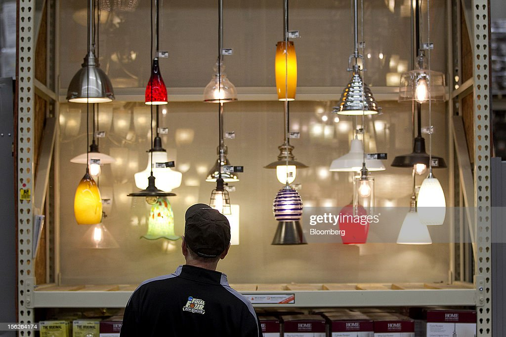 A customer looks at lighting fixtures at a Home Depot Inc. store in Washington, D.C., U.S., on Monday, Nov. 12, 2012. The Home Depot Inc. is scheduled to release earnings data on Nov. 13. Photographer: Andrew Harrer/Bloomberg via Getty Images