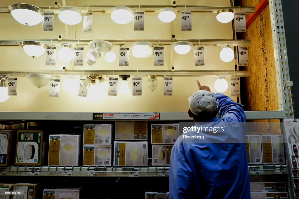 A customer looks at lighting fixtures at a Home Depot Inc. store in Washington, D.C., U.S., on Monday, Nov. 12, 2012. Home Depot Inc. is scheduled to release earnings data on Nov. 13. Photographer: Andrew Harrer/Bloomberg via Getty Images