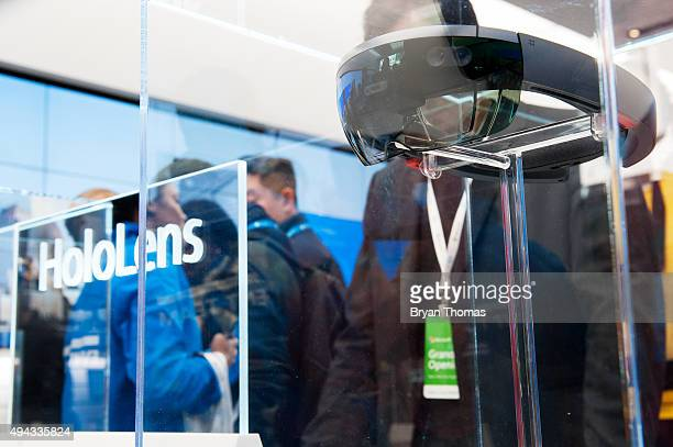 A customer looks at Microsoft's HoloLens at Microsoft's first flagship store on Fifth Avenue on October 26 2015 in New York City Hundreds of eager...