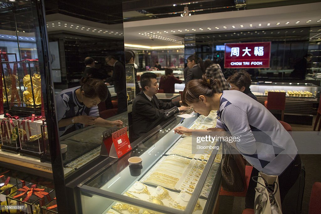 A customer looks at necklaces in a Chow Tai Fook Jewellery Group Ltd. store in the Central district of Hong Kong, China, on Wednesday, Jan. 16, 2013. Chow Tai Fook Jewellery, the world's biggest jeweler by market value, posted an 8 percent drop in third-quarter same-store sales as Chinese shoppers curbed spending amid a slower economy. Photographer: Jerome Favre/Bloomberg via Getty Images