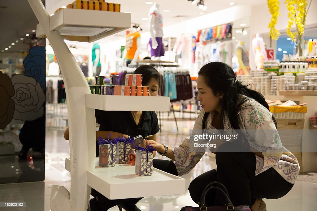 A customer looks at skin care products at the Discovery Shopping Mall in Kuta, Bali, Indonesia, on Tuesday, Oct. 8, 2013. Bank Indonesia said it will regulate currency hedging by individuals and companies, including state-owned firms, to help stabilize Asias most-volatile currency. Photographer: SeongJoon Cho/Bloomberg via Getty Images
