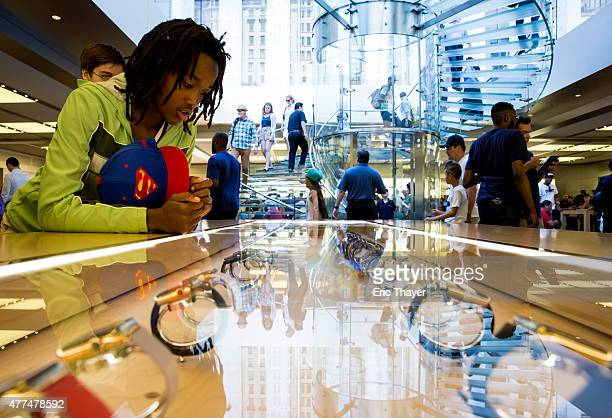 A customer looks at the Apple Watch at the Apple Store on June 17 2015 on Fifth Avenue in New York City The company began selling the watch in stores...