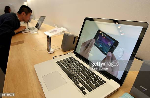 A customer looks at the new 17 inch MacBook Pro at an Apple store April 22 2009 in San Francisco California California Apple announced quarterly...