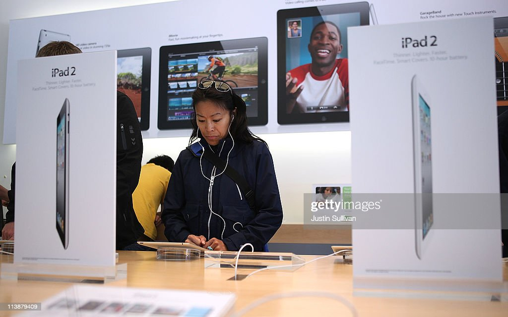 A customer looks at the new iPad 2 at an Apple Store following an announcement that Apple has become the world's most valuable brand on May 9, 2011 in San Francisco, California. In a report released by London based Millward Brown, Apple Inc. has surpassed Google to claim the top spot in a global ranking of brand value this year with an estimated value of more than $153 billion up 84 percent from last year.