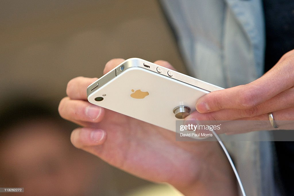 A customer looks at the new white iPhone 4 at the Apple store April 28, 2011 in Palo Alto, California. The long awaited white iPhone, first announced in June of 2010, went on sale worldwide for the first time today.