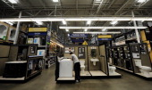 A customer looks in the bathroom renovation department at Lowe's home improvement store on April 11 2011 in Burbank California The home improvement...