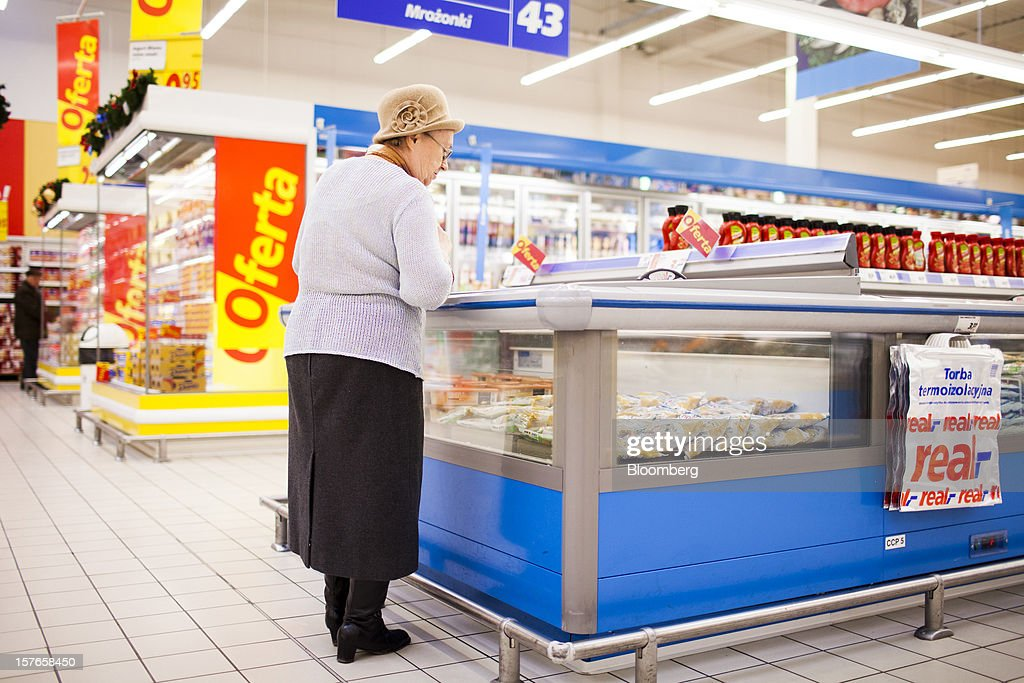 A customer looks inside a chilled food cabinet inside a Real supermarket in Wroclaw, Poland, on Wednesday, Dec. 5, 2012. Metro AG, Germany's biggest retailer, agreed to sell its Real grocery stores in eastern Europe to Groupe Auchan SA of France for 1.1 billion euros ($1.4 billion) in Chief Executive Officer Olaf Koch's first big deal since taking the helm. Photographer: Bartek Sadowski/Bloomberg via Getty Images