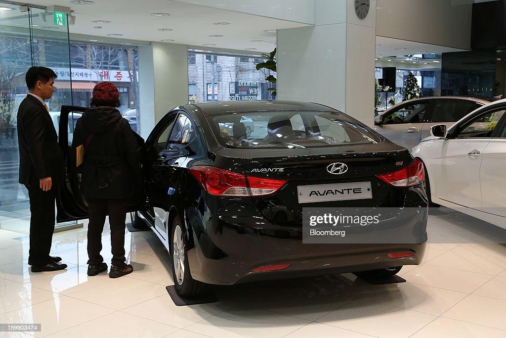 Customer looks inside a hyundai motor co avante sedan at a