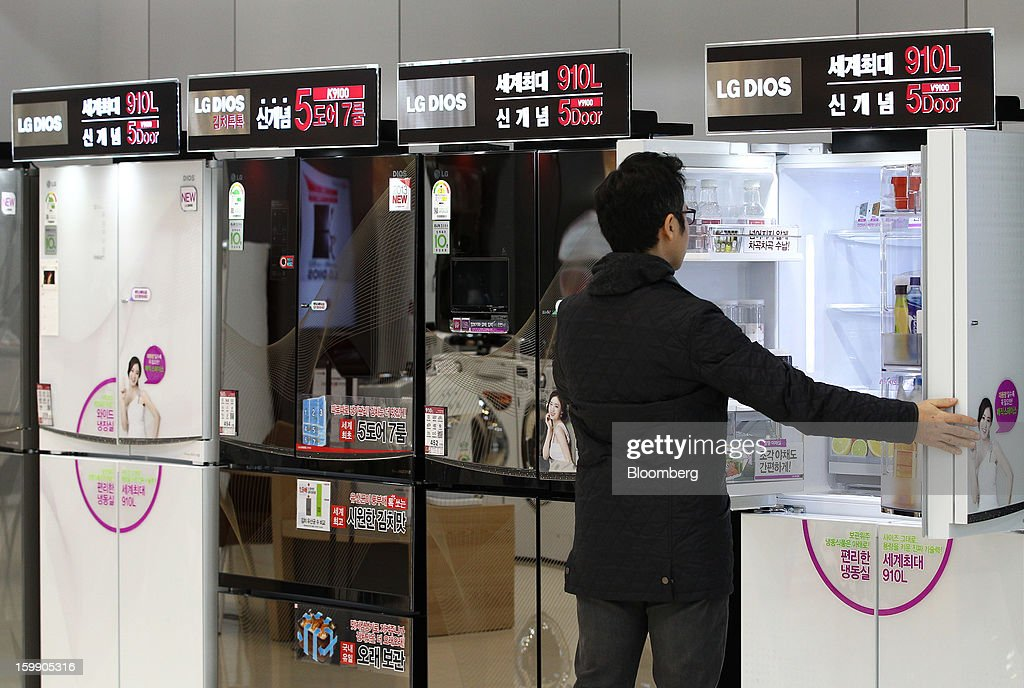 A customer looks inside an LG Electronics Inc. refrigerator at the company's flagship store in Seoul, South Korea, on Tuesday, Jan. 22, 2013. LG Electronics Inc. is scheduled to release fourth-quarter earnings on Jan. 30. Photographer: SeongJoon Cho/Bloomberg via Getty Images