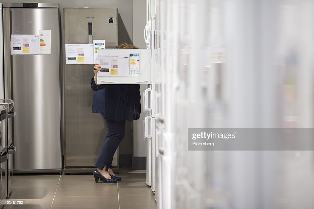 a customer looks inside the door a zanussi fridge freezer by ab electrolux