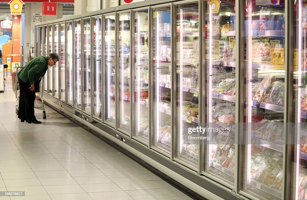 A customer looks into a freezer in the frozen foods section of a Mercator Poslovni Sistem d.d. supermarket in Ljubljana, Slovenia, on Wednesday, May 8, 2013. In January Mercator reported its first full-year loss in fifteen years as the largest supermarket chain's sales in the Balkans last year suffered during the recession. Photographer: Chris Ratcliffe/Bloomberg via Getty Images