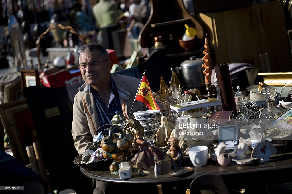 A customer looks on in a second hand furniture shop at a second hand market on November 9, 2011 in Barcelona, Spain. The current Eurozone debt crisis has left Spain with crippling economic problems. Mounting debts, record unemployment figures and the recent credit rating downgrade is leaving the country facing further economic stagnation. The people of Spain are preparing to go to the polls for a general election which will be held on November 20, 2011.