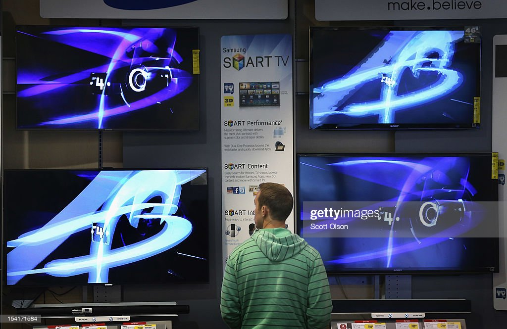 A customer looks over televisions offered for sale at a Best Buy store on October 15, 2012 in Chicago, Illinois. Retail sales rose 1.1 percent last month with electronics and appliances leading the way with a 4.5 percent increase in sales.