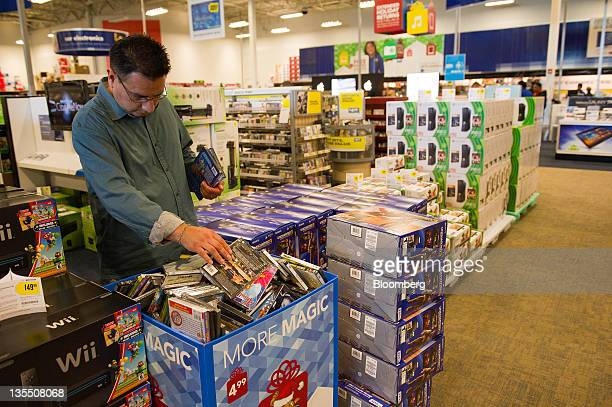 A customer looks shops for movies at a Best Buy Co store in San Francisco California US on Friday Dec 9 2011 Best Buy the electronics appliance and...