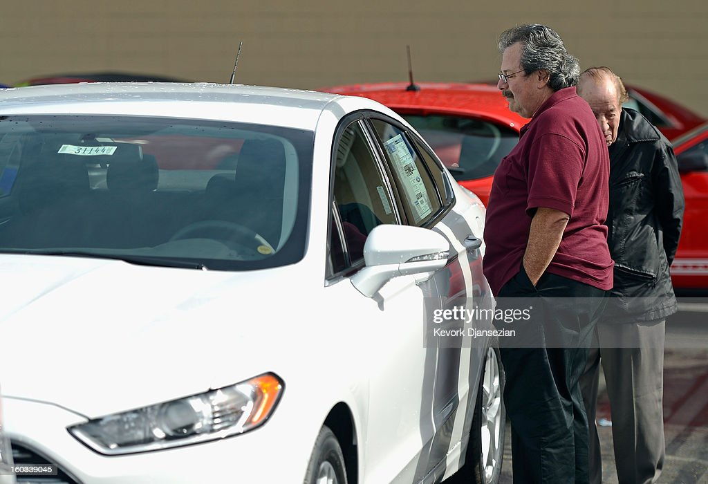 A customer looks to buy a Ford Fusioin at Star Ford dealership on January 29, 2013 in Glendale, California. According to reports the nation's second-largest automaker earned $1.7 billion in the fourth-quarter quarter, the highest pre-tax profit in a decade, up 55% from a year earlier. For the year, earnings slipped 5% to $5.7 billion.