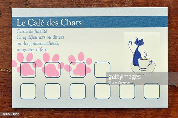 A customer loyalty card for Le Café des Chats on October 25 2013 in Paris France Inspired by neko cafes in Japan Margaux Gandelon opened a cafe where...
